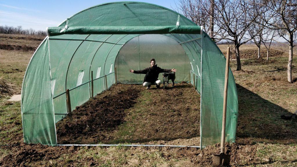 gardener inside an empty green house